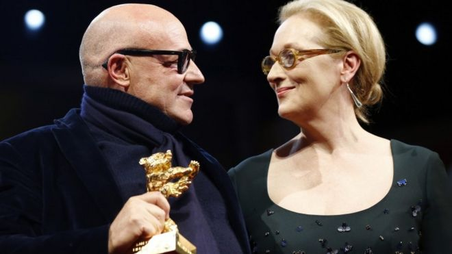 Gianfranco Rosi accepts the Golden Bear from Meryl Streep, 20 Feb