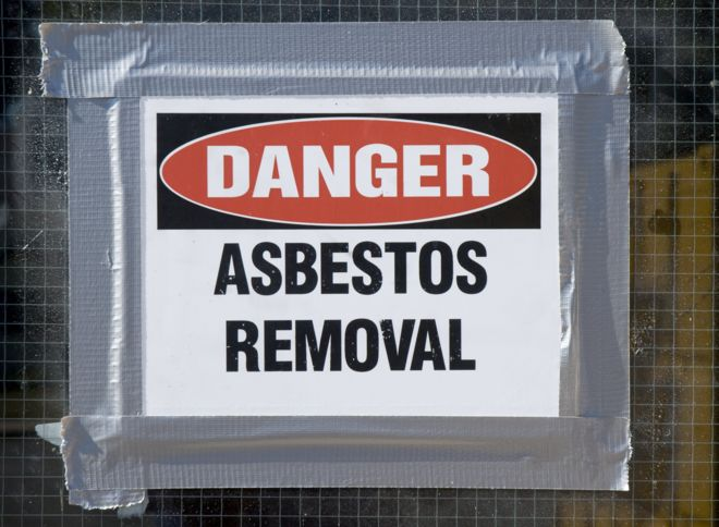 A picture of danger asbestos removal sign