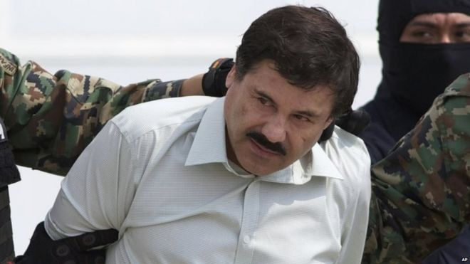 """Joaquin """"El Chapo"""" Guzman, head of Mexico's Sinaloa Cartel, is escorted to a helicopter in Mexico City, following his capture overnight in the beach resort town of Mazatlan 22 February 2014"""