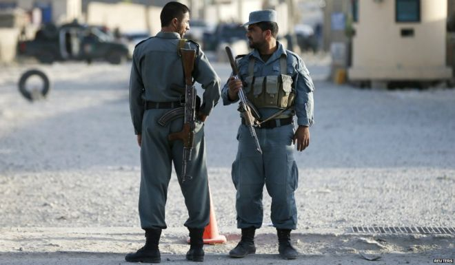 Afghan policemen keep watch at the site of an attack outside a base in Kabul, Afghanistan - 8 August 2015