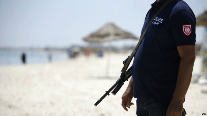 A Tunisian policeman patrols the beach in Sousse - 28 June 2015