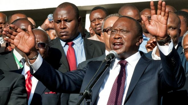 "Uhuru Kenyatta (C) speaks following his victory in Kenya""s national elections in Nairobi on March 9, 2013."