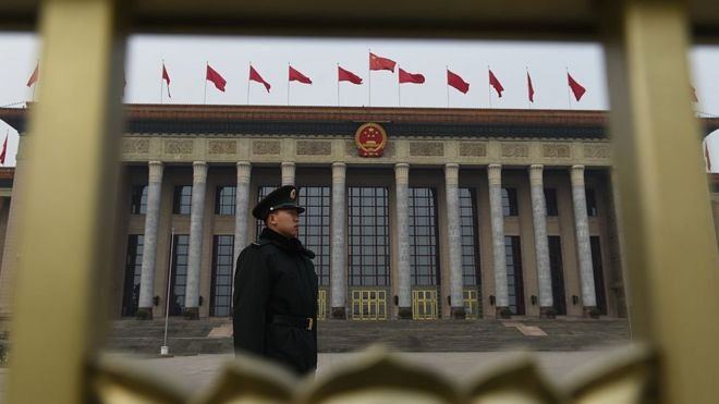 A Chinese soldier stands guard outside the Great Hall of the People as National People's Congress meetings continue inside in Beijing on 15 March 2016