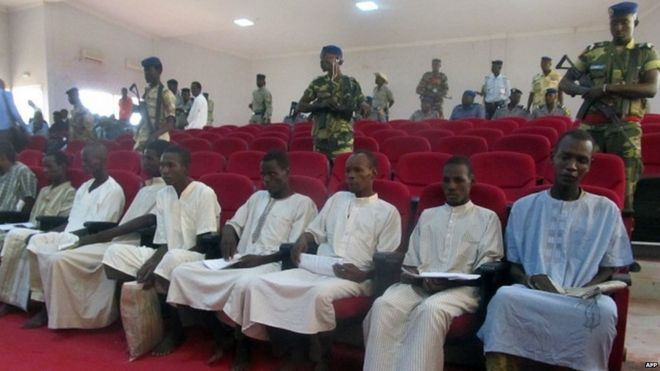 "members of Nigeria-based Islamist group Boko Haram sitting in court in N""Djamena, during the opening of the trial of ten suspected Boko Haram members"
