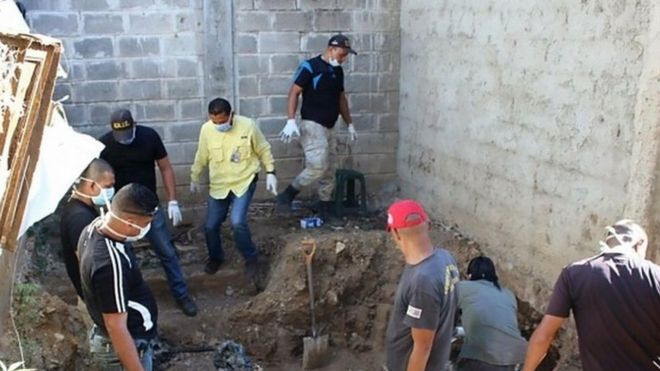 Forensic personnel study the remains of bodies discovered in the General Penitentiary of Venezuela, which has been closed down, in San Juan de los Morros, Guarico state, on March 10, 2017