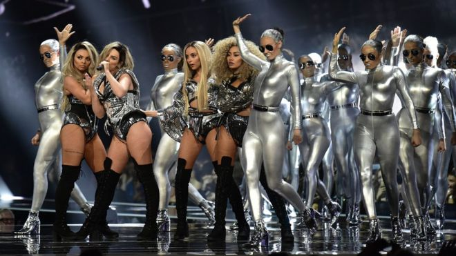 Little Mix on stage at the Brits