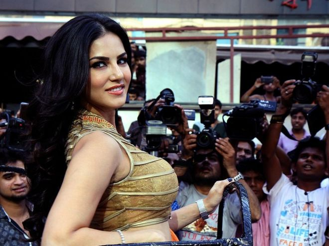 Indian actress and former adult film actress Sunny Leone poses for a photograph during a promotional event for the Hindi film Ragini MMS 2 in Mumbai on late March 26, 2014.