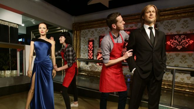 Studio assistants Alex Cameron and Olivia Steen move apart the wax figures of Brad Pitt and Angelina Jolie at Madame Tussauds London following the news of their divorce. PRESS ASSOCIATION Photo. Picture date: Wednesday September 21, 2016.