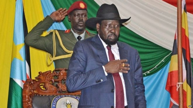 "South Sudan""s President Salva Kiir (C) stands for South Sudan""s national anthem before signing a peace agreement in the capital Juba, on August 26, 2015."