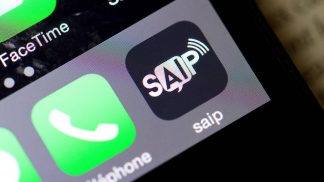 Photo taken on June 8, 2016 shows smartphone with logo of SAIP (Systeme d'Alerte et d'Information aux populations, or Population Alert and Information System)