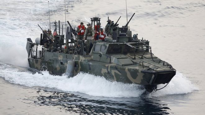 A US riverine patrol boat operates in the Gulf