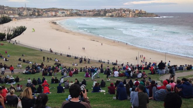 Onlookers gathered at Bondi Beach in Australia in the hope of catching a first glimpse of the supermoon