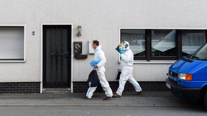 German police examine a house near the Czech border where several dead babies were found