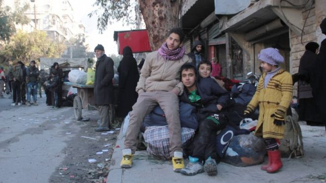 Children sit with their baggage during the evacuation, Aleppo, Syria, 15 December 2016