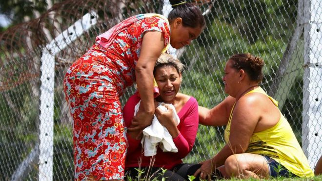 The wife of a prisoner who was killed in a riot cries outside Anisio Jobim Penitentiary Complex in Manaus