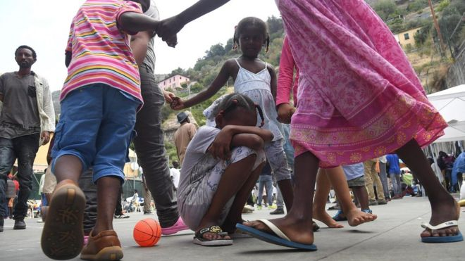 Migrant children play on a sports field on the premises of the Sant'Antonio Parish in Ventimiglia, Italy, 08 July 2016