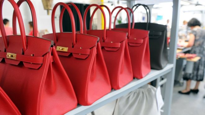 File image of luxury handbags on a shelf