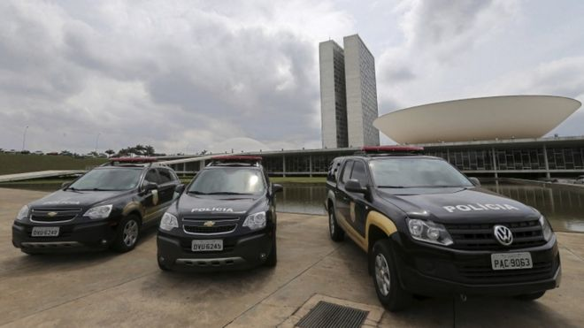 Senate police cars outside the Congress building in Brasilia, October 2016