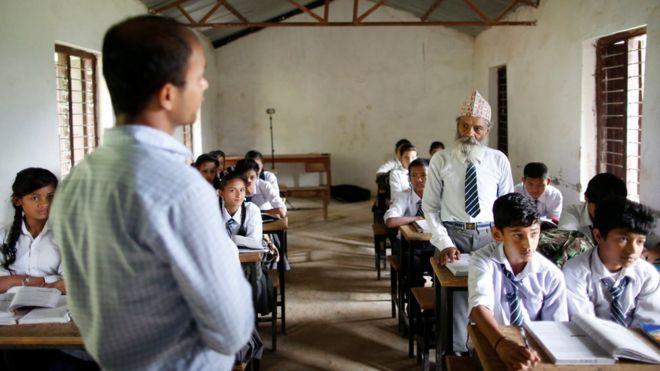 Durga Kami answers a question from his teacher