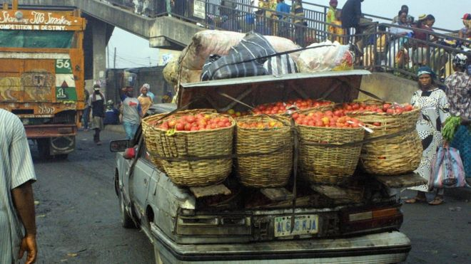 A vehicle overloaded with perishable foods heads to downtown Lagos from the Mile 12 market, 09 January 2006.