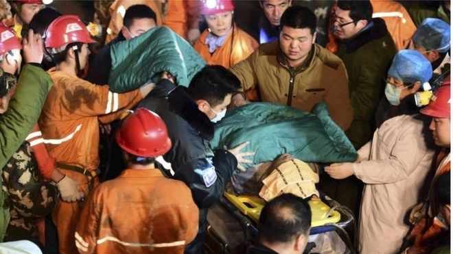 A trapped miner is rescued from a collapsed gypsum mine in Pingyi County, east China's Shandong Province on 25 December.