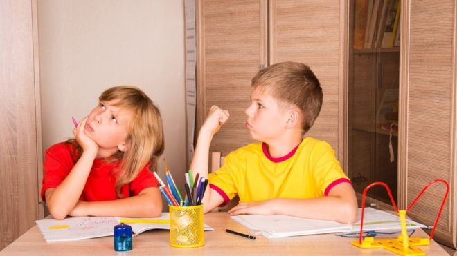 Children quarrelling over homework