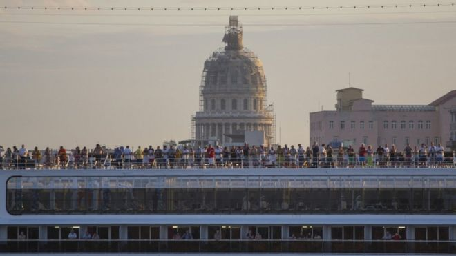 Cruise travellers on the deck of the MSC Opera cruiser as it leaves the harbour in Havana, 4 Feb 2016