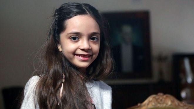 Bana Alabed, 7, is pictured smiling in a professional news shot from the safety of Turkey in December