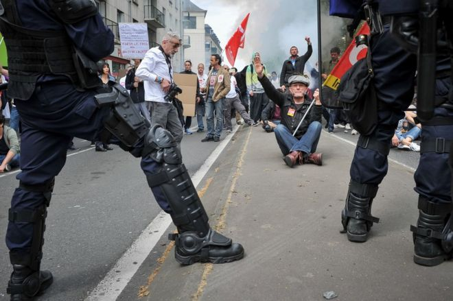 Riot police face protesters in the French city of Tours, 26 May