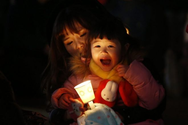 Mujer con niña en Corea del Sur