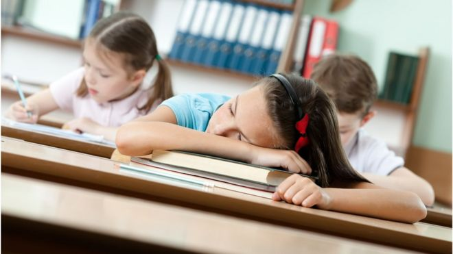 Pupil asleep on desk