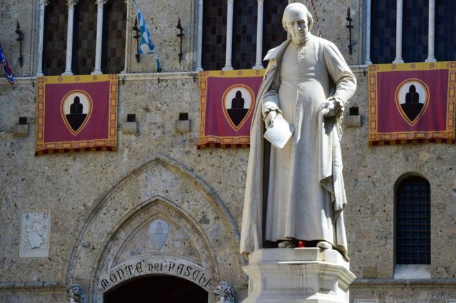 A statue of priest Sallustio Bandini at Piazza Salimbeni, the headquarters of the Monte dei Paschi di Siena bank in Siena, Tuscany.