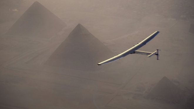 The Solar Impulse flying over the pyramids in Egypt