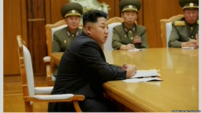 Screen grabs of Kim Jong-un attending the emergency expanded meeting of central military commission on the night of 20 August 2015