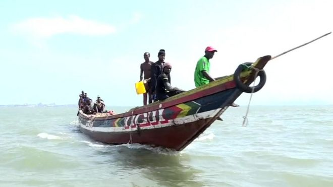 The wooden canoes of Guinea's fishermen are dwarfed by Chinese trawlers