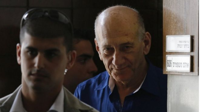 Former Israeli Prime Minister Ehud Olmert (right) leaves Tel Aviv District Court, in this 2014 file picture