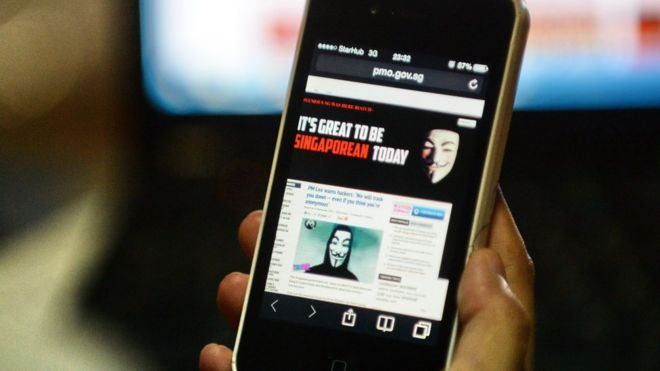 Activist hacker group Anonymous is seen through the internet government website of Singapore Prime Minister Office circulated online on a smartphone in Singapore on November 7, 2013.