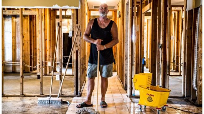 "Phillip ""Mooney"" Brignac, 58, finishes the clean-up of his home in St Amant. He has lived there since 1991, adding to it while raising two children. ""We will definitely rebuild. We are St Amant strong. We will do whatever we've got to do,"" he said. St Amant, LA"