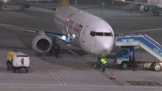 A plane parked at a Turkish airport after an explosion nearby