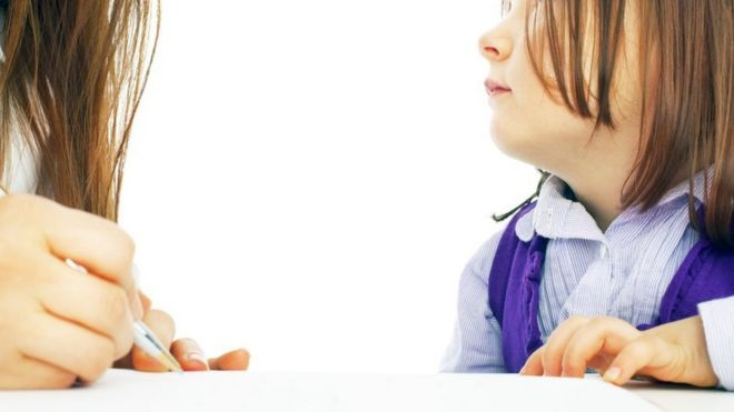 Child looks up ad adult