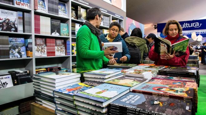 Visitors attend the 42nd Angouleme International Comics Festival (Festival international de la bande dessinee d'Angouleme) on Friday 30, 2015 in Angouleme, central France
