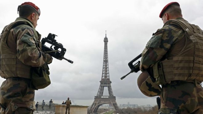 Soldiers patrol near the Eiffel Tower