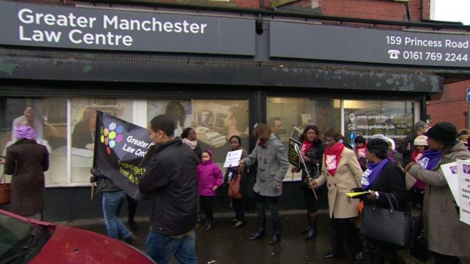 People march past the Greater Manchester Law Centre