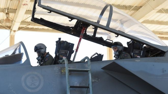 Saudi pilots sitting in a F-15 fighter jet at the Khamis Mushayt military airbase, file