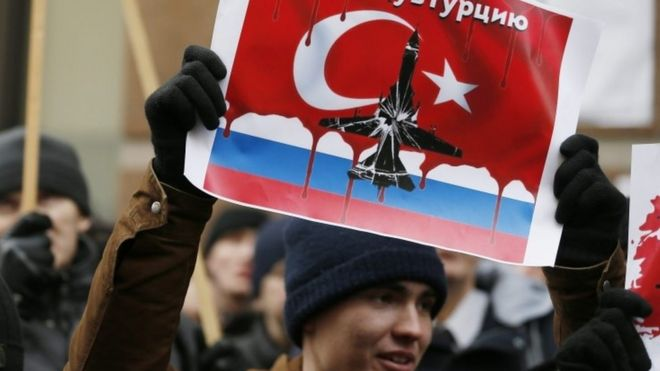Russians protest the downing of a Russian jet outside the Turkish embassy