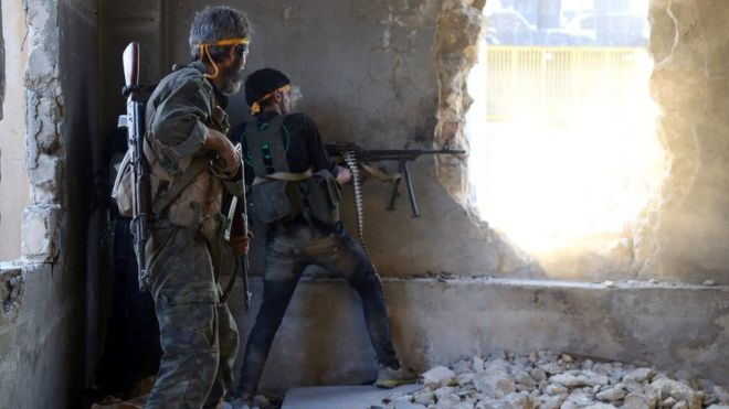 File photo showing Syrian rebel fighters in Ramouseh district of Aleppo (6 August 2016)