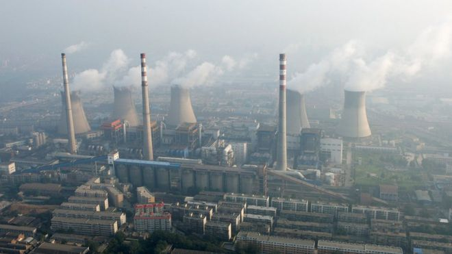 An aerial view shows a coal-burning power plant on the outskirts of Zhengzhou, Henan province, China, August 28, 2010.