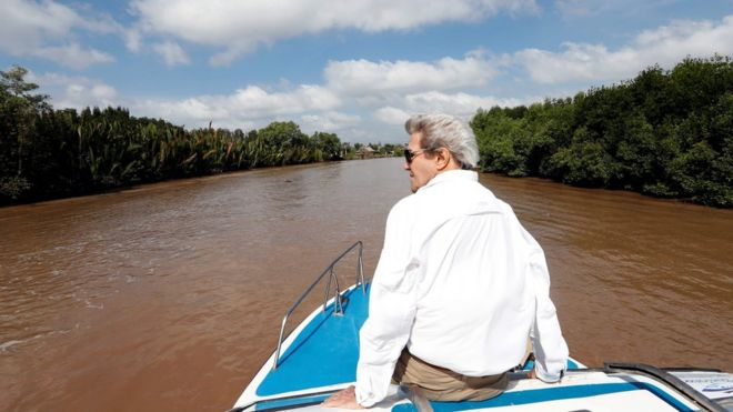 US Secretary of State John Kerry rides a boat in the Mekong Delta