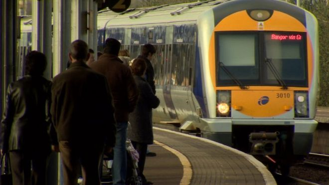 A train approaching the platform at a station in Belfast