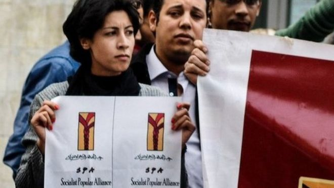 Activist Shaimaa al-Sabbagh holds up a poster at a protest in Cairo shortly before her death (24 January 2015)